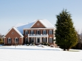Modern single family home in snow
