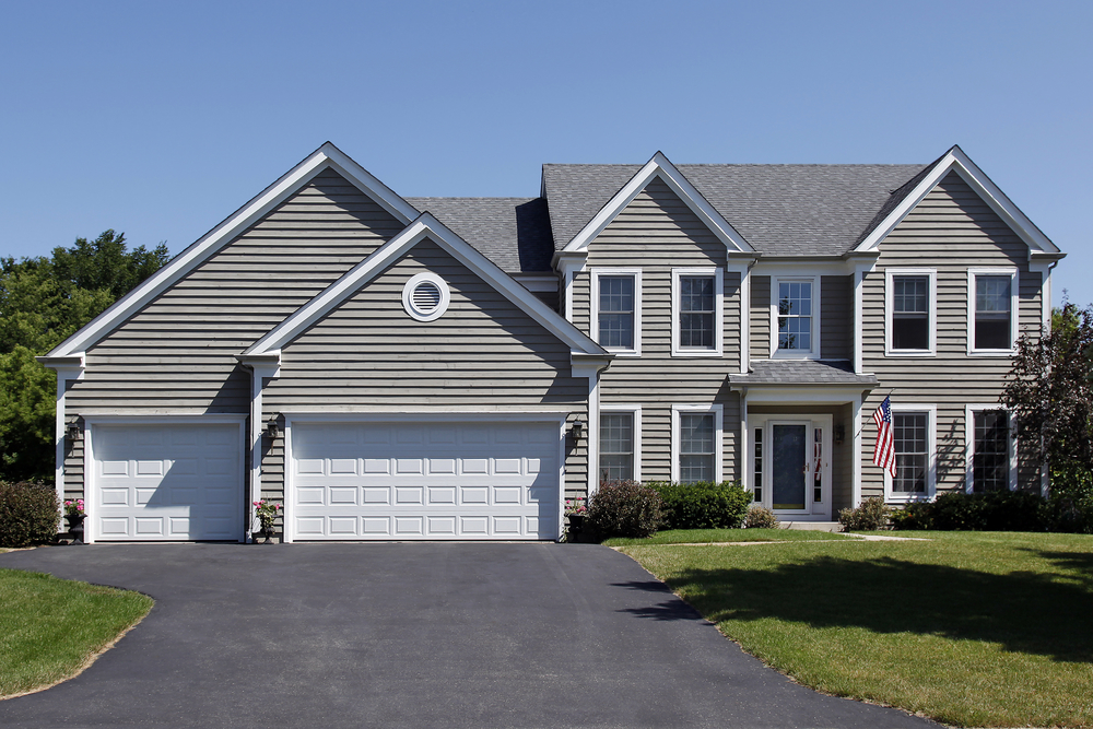 Suburban home with gray siding and covered entry